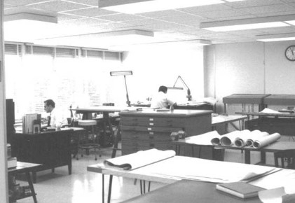 SK&A's former 6110 Executive Blvd., Rockville office (circa 1965). Azer at his desk in foreground.