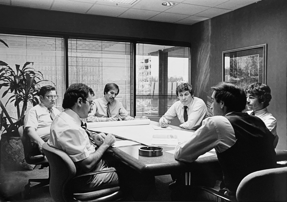Staff meeting in SK&A's Rockville office conference room.  Partner (now retired), Cetin Karabulut, 3rd from right.