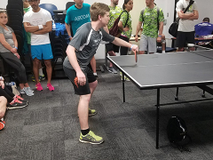 James competing in table tennis.