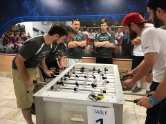 Michael and Steve competing in foosball.