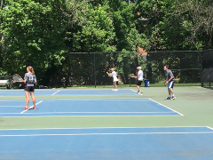 Catherine & Stefan competing in the mixed doubles tennis.