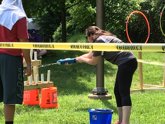 Gabi competing in the obstacle course relay.
