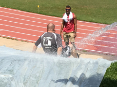 Murat going down the slip and slide in the obstacle course relay.