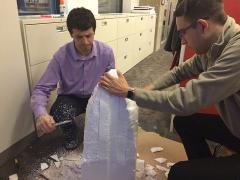 David B. and Sikandar cutting away at the foam model.