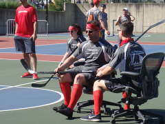 Macenzie, Steve, and Frank Competing in Chair Hockey