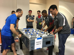 Landon and Ahmed Competing in Foosball