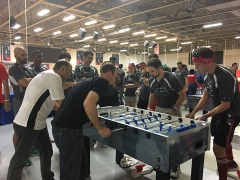 Mike and Jon Competing in Foosball