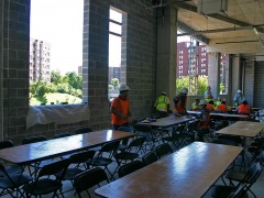 Construction workers on-site prepare for the Topping Out party and a delicious lunch.