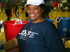 SK&A MD receptionist, Cherie McKinney volunteers a helping hand.