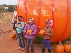 Nia, Zaire, and Aniah at the pumpkin patch.