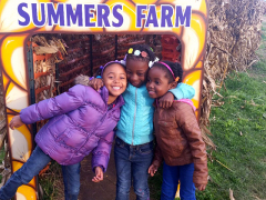 Nia, Zaire, and Aniah in front of the pumpkin train.