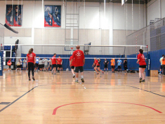 Indoor volleyball team warming up.